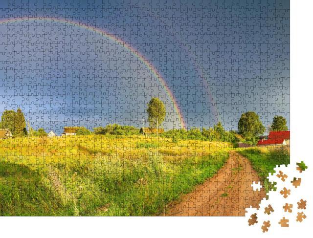 """Puzzle 1000 Teile """"Regenbogen über dunklen Regenwolken in ländlicher Landschaft"""""""