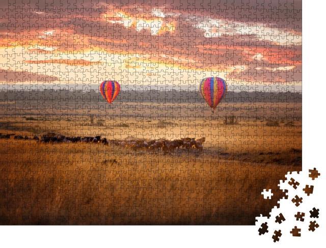 """Puzzle 1000 Teile """"Sonnenaufgang über der Masai Mara mit einer Herde Gnus"""""""