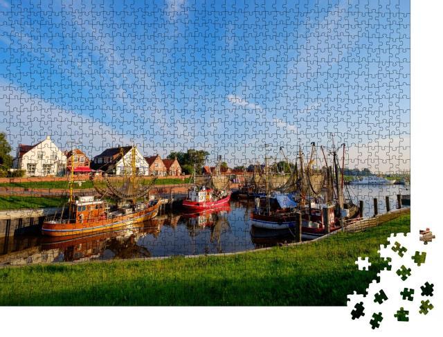 """Puzzle 1000 Teile """"Der Fischereihafen von Greetsiel, Deutschland"""""""