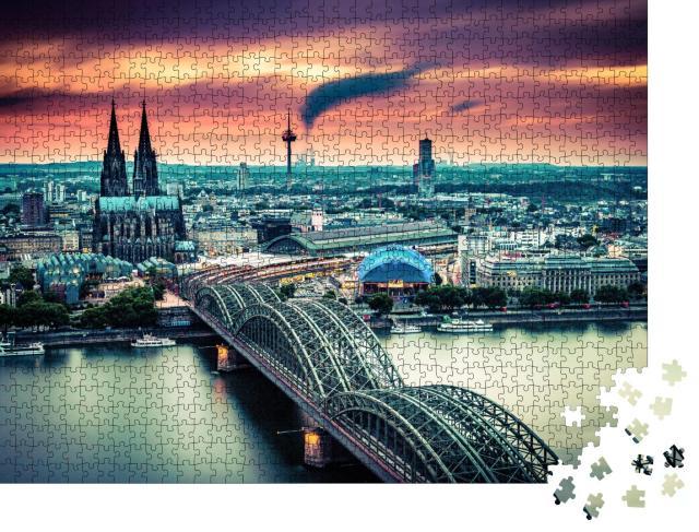 """Puzzle 1000 Teile """"Sonnenuntergang und bewegte Wolken über Köln, Deutschland"""""""