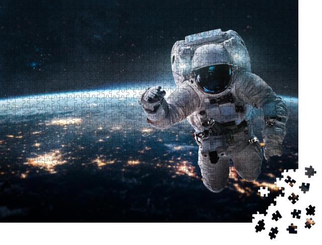 """Puzzle 1000 Teile """"Astronaut schwebt über der Erde bei Nacht"""""""