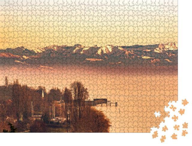 """Puzzle 1000 Teile """"Abendleuchten am Bodensee mit Schweizer Alpen"""""""