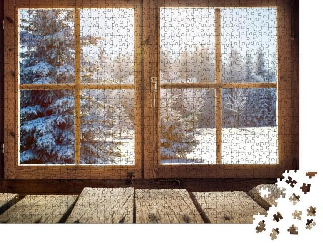 """Puzzle 1000 Teile """"Blick durch ein Hüttenfenster auf den verschneiten Winterwald"""""""