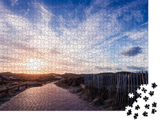 """Puzzle 1000 Teile """"Wolken über dem Radweg auf Norderney"""""""