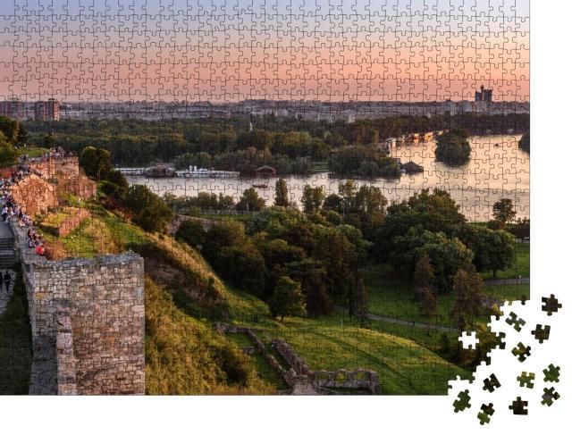 "Puzzle 1000 Teile ""Sonnenuntergang am Belgrad Turm Kalemegdan auf Sava Fluss"""