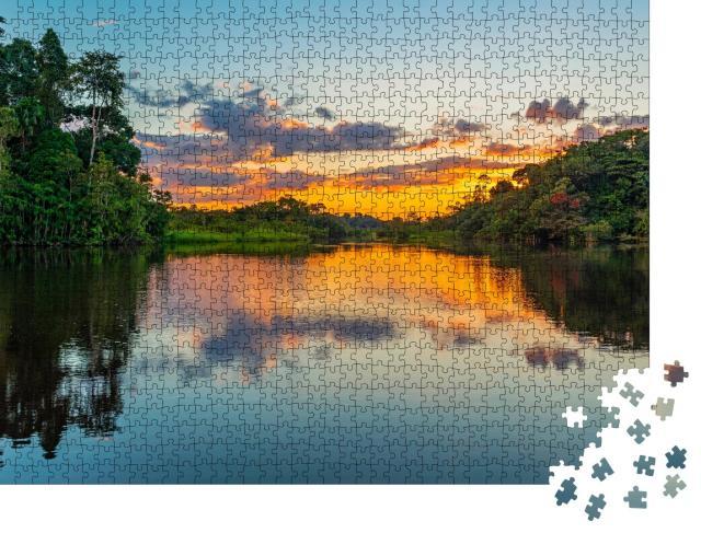 """Puzzle 1000 Teile """"Sonnenuntergang an einer Lagune im Amazonas-Regenwaldbecken"""""""