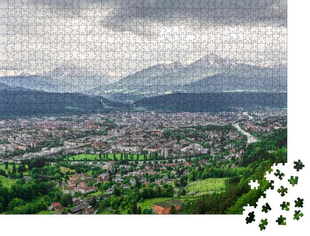 """Puzzle 1000 Teile """"Skyline der Alpenstadt Innsbruck in Österreich"""""""