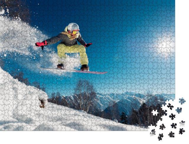 """Puzzle 1000 Teile """"Snowboarderin beim Sprung"""""""