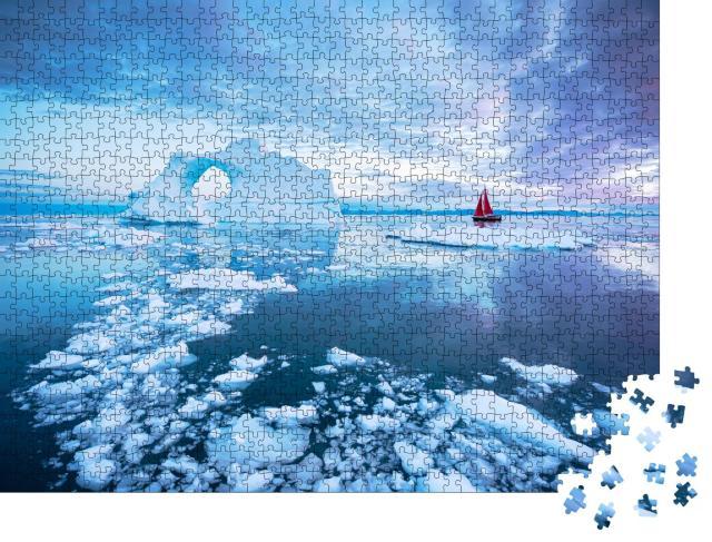 """Puzzle 1000 Teile """"Segelboot mit roten Segeln kreuzt neben einem durchbrochenen Eisberg """""""