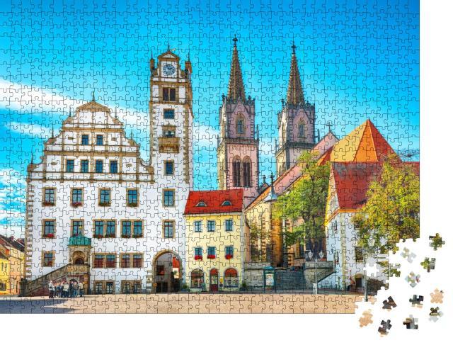 """Puzzle 1000 Teile """"Stadtbild des Oschatzer Hauptplatzes mit Stadtverwaltung und St. Aegidien, Sachsen"""""""