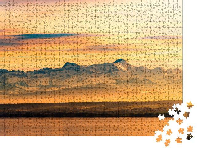"""Puzzle 1000 Teile """"Abendleuchten am Bodensee mit Schweizer Alpen im Hintergrund"""""""