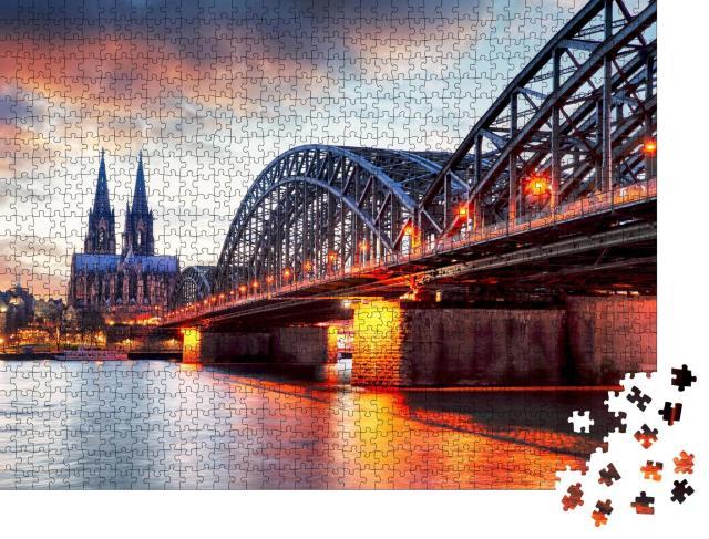 """Puzzle 1000 Teile """"Kölner Dom und Hohenzollernbrücke im Sonnenuntergang"""""""
