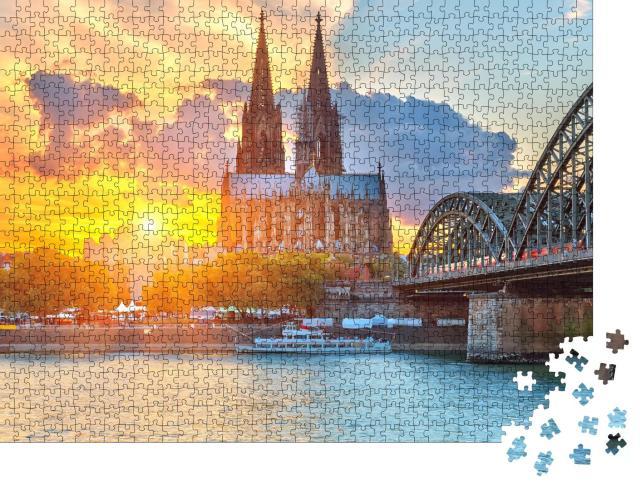 """Puzzle 1000 Teile """"Blick auf den Kölner Dom im goldenen Sonnenuntergang"""""""