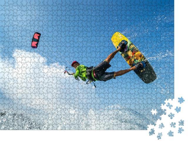 """Puzzle 1000 Teile """"Ein Kite-Surfer beim Sprung über den Wellen"""""""