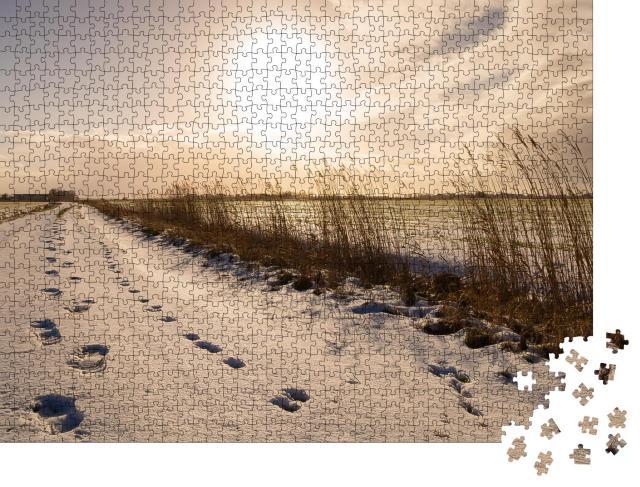 """Puzzle 1000 Teile """"Fußspuren durch den Schnee, Ostfriesland"""""""
