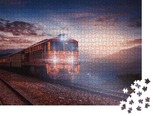"""Puzzle 1000 Teile """"Zugfahrt in der Abenddämmerung"""""""