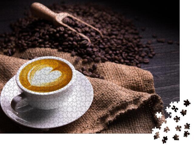 """Puzzle 1000 Teile """"Tasse Kaffee mit Milchschaum-Herz, im Hintergrund geröstete Kaffeebohnen"""""""