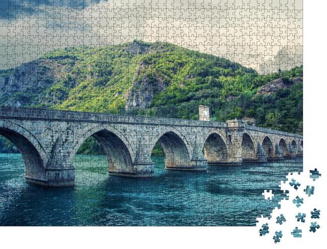"""Puzzle 1000 Teile """"Die Brücke über die Drina"""""""